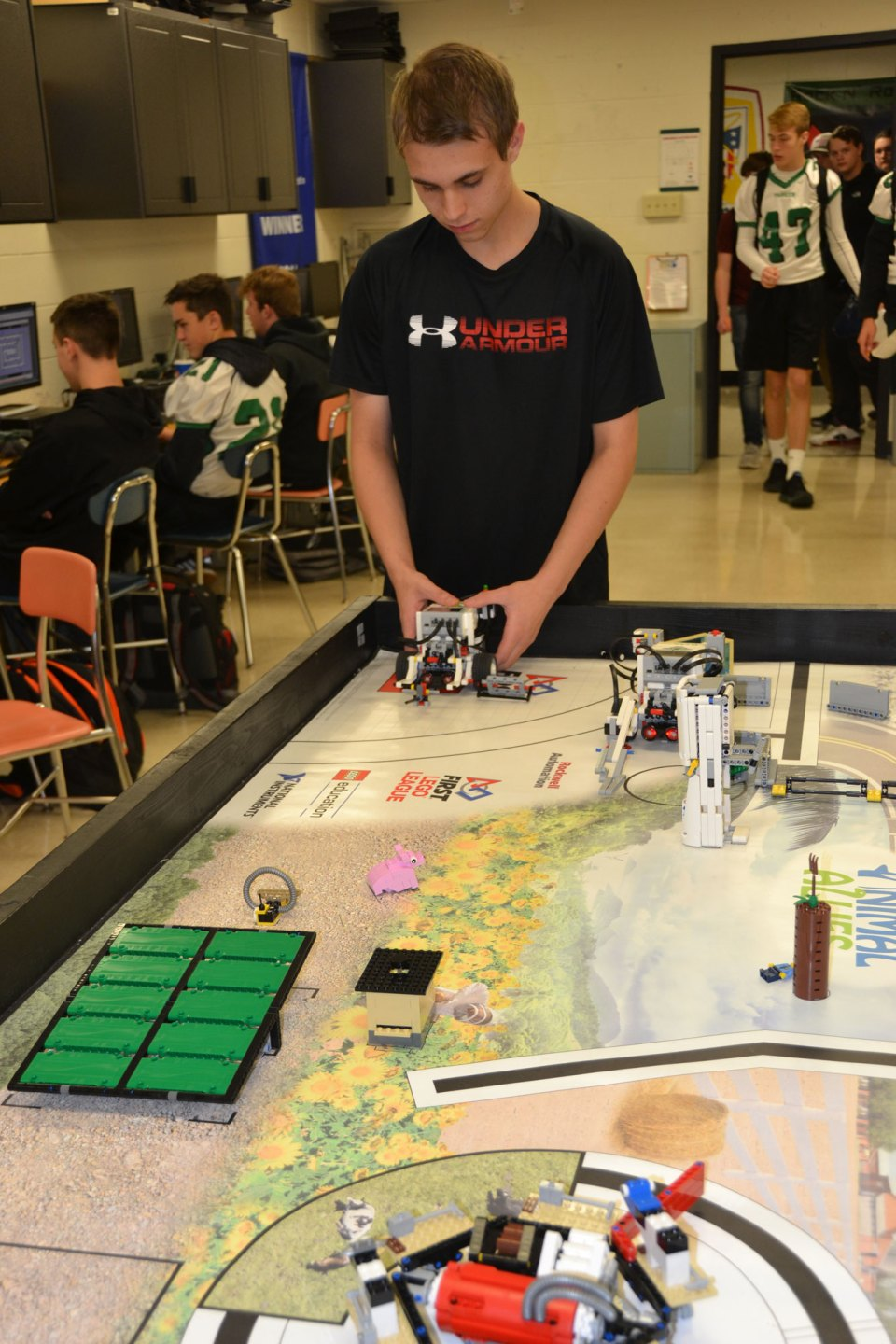 A student at Parker High School, in Janesville, Wisconsin, shows off the robot he has programmed. Parker students often travel to robotics competitions around the country.