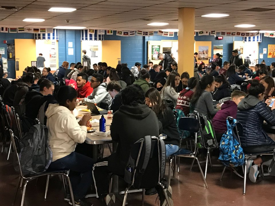 Revere High School students eating and socializing in the cafeteria.