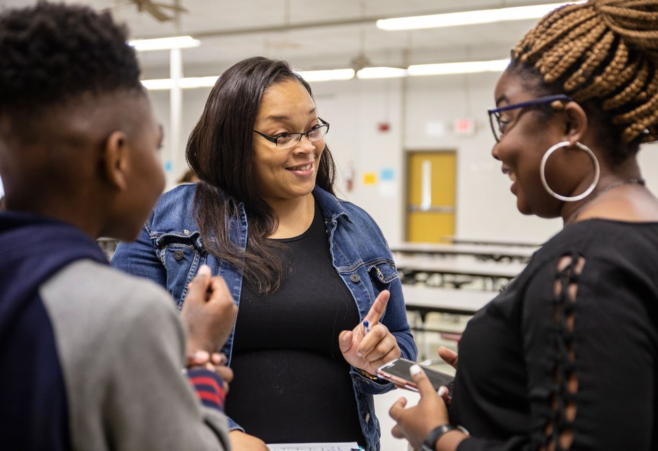 Vernita Burnett, center, shares a laugh with student SeMarje McGregory, left, and English teacher K'Acia Drummer at W.A. Higgins Middle School in Clarksdale last October.