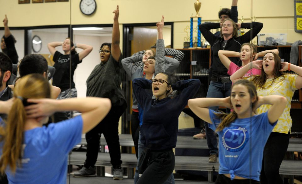 Rosie Stone, center, and other students in the Atchison High School show choir rehearse in their upgraded studio, paid for with a voter-supported bond measure for campus improvements.