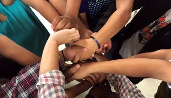 """Taos High students work together to untie a """"human knot"""" during an icebreaker led by seniors during the school's 2018 EQ Retreat."""