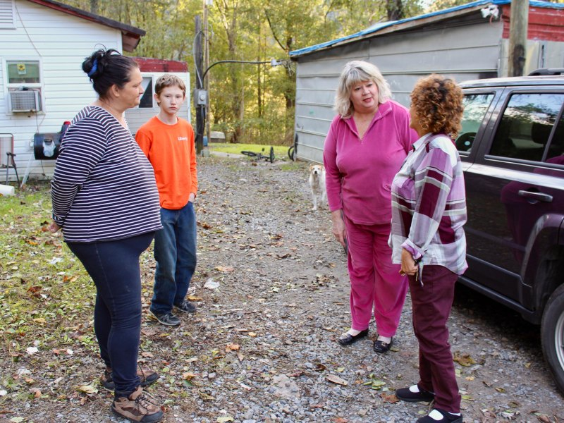 (Left to right) Carol Cannon and her son, Johnathan, welcome teachers Cathy Jack and Pamela George for the first of two visits the pair will make to their Hemphill, West Virginia, home. The second visit will follow early in the new year.