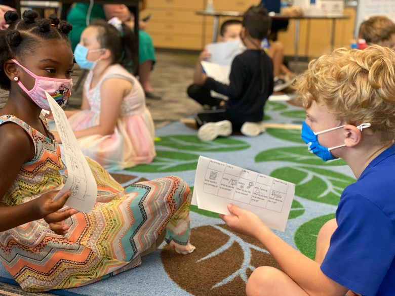 Carin Coleman (left) and Robert Tabshy, both 7, discuss their favorite summer pastimes during an activity meant to get kids talking to each other, something that was hard during a school year that was mostly online. Carin and Robert are both students at Lot Whitcomb Elementary School in Milwaukie, Ore.