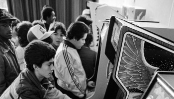 People play video games at a New York game arcade in December 20, 1981. (AP Photo/G. Paul Burnett)