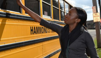 Krystal Hardy, the new principal at Sylvanie Williams in New Orleans, waves good-bye to her students after a long day. (Photo: Peg Tyre)