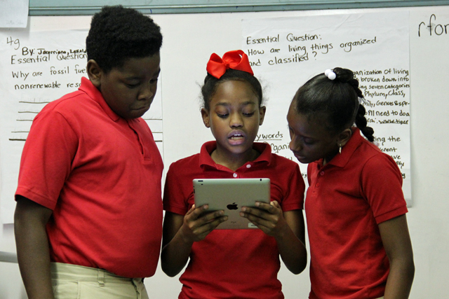 Students in Reginald Forte's fifth-grade class at Em Boyd Elementary in Greenville present projects on iPads. (Photo by Jackie Mader)
