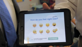 Teachers at Piedmont Elementary School use iPads each morning with the school's youngest students to check student emotions before beginning class work. (Photo by Jackie Mader)