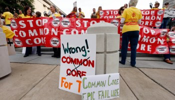 People protesting the Common Core education standards demonstrate near the hotel where the meeting of Tennessee's Education Summit is taking place in Nashville, Tenn.