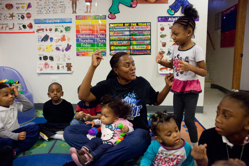 Paulette Harvey is only required to have a high school diploma to run her home day care business but has a bachelor's degree. The federal Race to the Top competition has given states an incentive to toughen their standards. (Photo: Armando L. Sanchez)