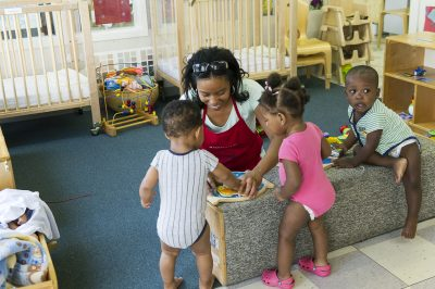 Educare assistant teacher Sharlonda McNeil helps cultivate a curiosity about learning in her young pupils. (Kim Palmer / Hechinger Report)