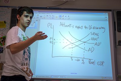 "New Rochelle High School senior Esteban Acevedo, seen her plot ting graphs in economics class in January 2014, says he's ""hopeful but kind of nervous"" about the financial aid application process. The Columbian immigrant, who  hopes to become a doctor, says he and his parents – who work as a porter and a home attendant – figure out the aid questions together and depend on a school counselor for those they can't. (Photo: Ann Hermes/The Christian Science)"