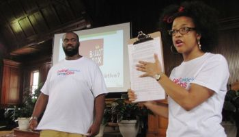 Field directors Charles Taylor and Amber Thomas explain how the ballot initiative works to the audience. (Photo: Kayleigh Skinner/The Hechinger Report )