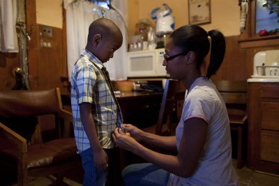 Mesha Exum helps her 5-year-old son, Arimus Mosley, get dressed for school at Educare, a Chicago preschool that he has attended since he was a baby. Thanks in part to support from the school, Exum recently completed her bachelor's degree and enrolled in a master's program in accounting. (Armando L. Sanchez / NBC News) Reproduction not permitted