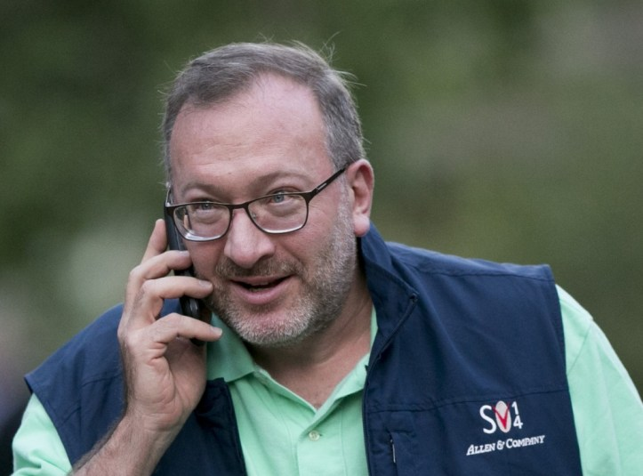 Seth Klarman, founder of the Baupost Group LLC, talks on the phone while arriving to a morning session during the Allen & Co. Media and Technology Conference in Sun Valley, Idaho, U.S., on Thursday, July 10, 2014. Technology companies from Silicon Valley are expected to take center stage at this year's Allen & Co.'s Sun Valley conference as tech and media converge. Photographer: Scott Eells/Bloomberg *** Local Caption *** Seth Klarman