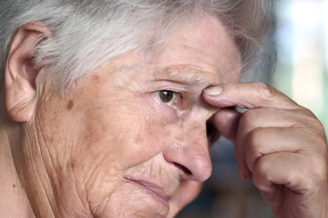 elderly woman having problem. shallow depth of field with focus on the first eye.