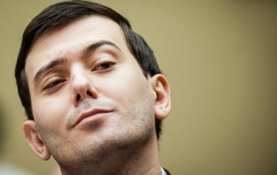 """Martin Shkreli, former chief executive officer of Turing Pharmaceuticals LLC, reacts during a House Committee on Oversight and Government Reform hearing on prescription drug prices in Washington, D.C., U.S., on Thursday, Feb. 4, 2016. Shkreli, who is no longer with Turing and faces federal fraud charges unrelated to the drugmaker, declined to make any comments to the committee. """"On the advice of counsel, I invoke my Fifth Amendment,"""" Shkreli said. Photographer: Pete Marovich/Bloomberg via Getty Images"""