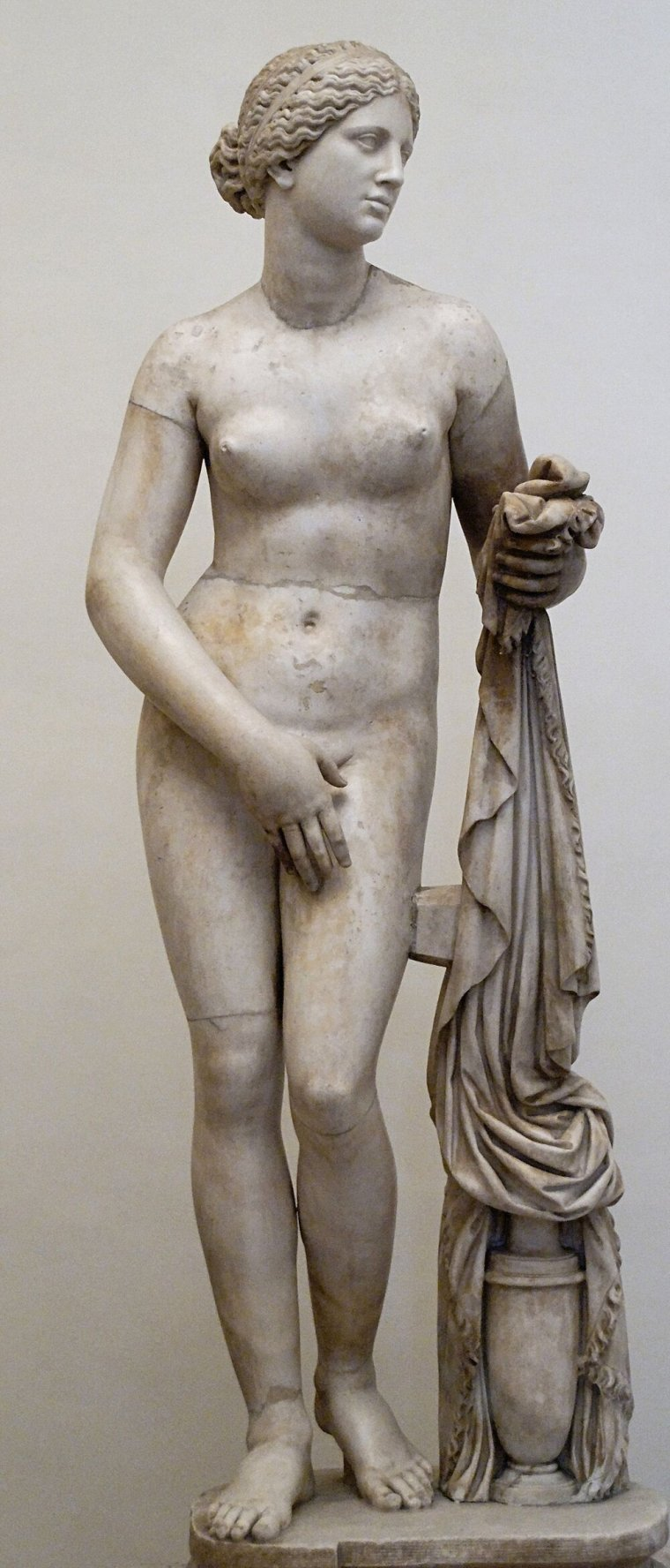 The statue Aphrodite of Knidos created in 350 BCE was the first to monumental statue to be created showing a female in the nude. At the time women were widely regarded like property; victims to the unfortunately circumstances of their birth into a woman's body. The choice to show her naked is significant. Art historians theorize that the water jug is intended to suggest that she is about to take a bath, but it seems relevant that the is not looking coyly away, but her head is held nigh. To us, this is classic art. At the time it was created it was not well received as it depicted women far more powerfully than was considered the norm. Aphrodite's naked form is an artistic testament here to her power and equal status among the gods.   - Why is nudity in art relevant here? Art is symbolism, magick is symbolism, and art is magick! By studying the meaning behind these artistic choices it can give us insight and clues into why it become common practice in witchcraft and spirituality for nudity to be something of a virtue.