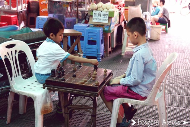 Little boys playing in the market