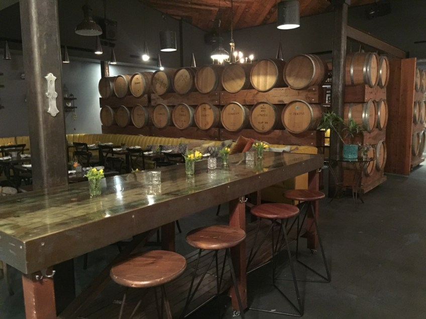 Madera Kitchen and Bar Interior Communal Table and Barrels