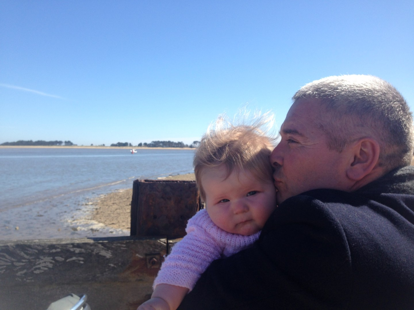 Baby and daddy on beach