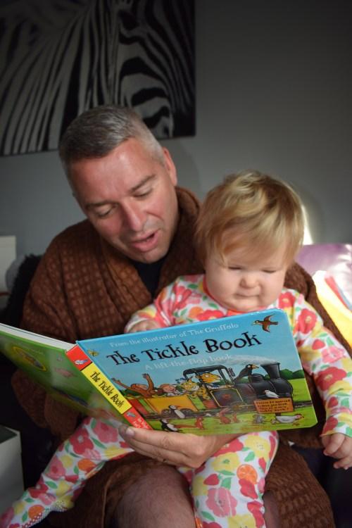 Birthday baby reading book