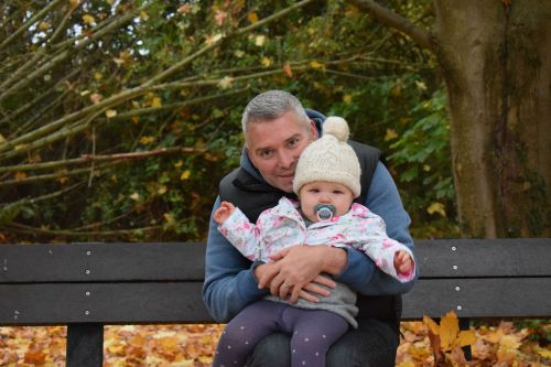 Father and daughter on a bench