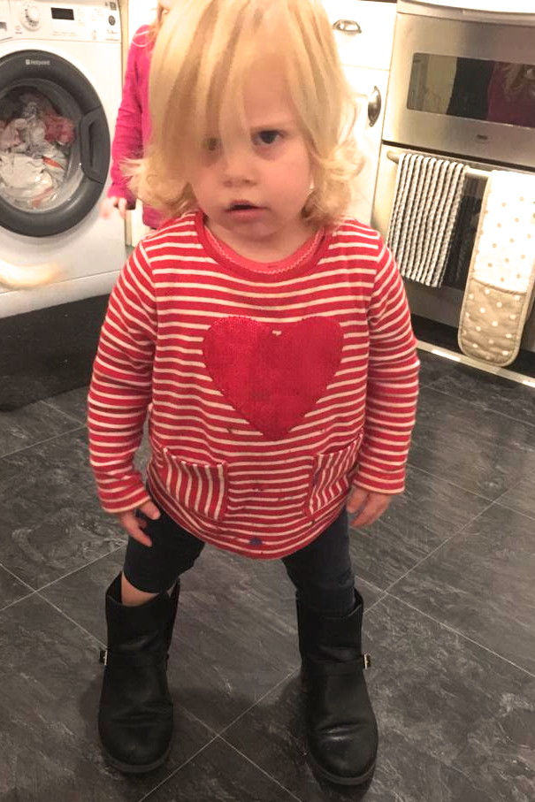 22 months old girl wearing adult boots