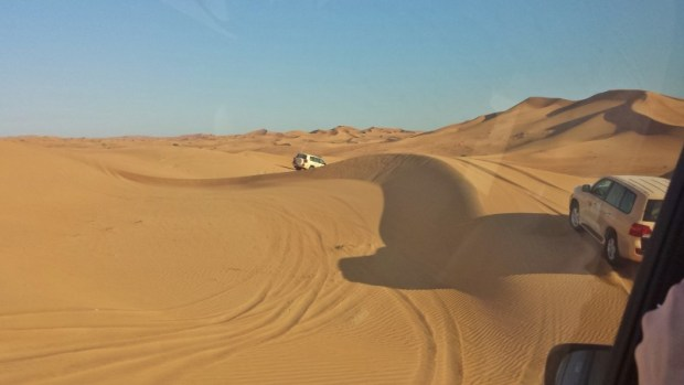 Al Maha Resort Dune Bashing activity multiple vehicles