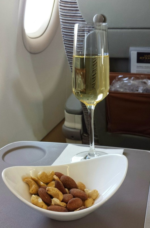 Etihad Business Class AUH MAA nuts and champagne