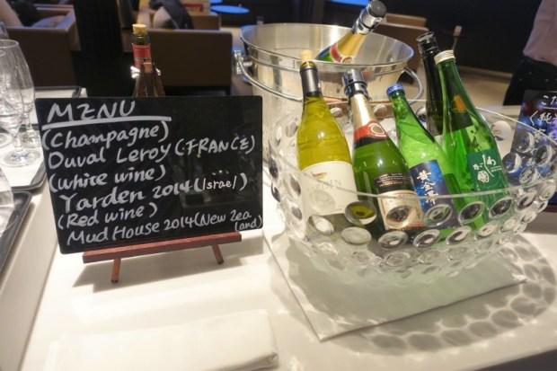 JAL First Class Sakura Lounge Narita Satellite wine