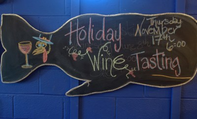 topsail-beach-nc-quartermoon-bookstore-holiday-wine-tasting-sign