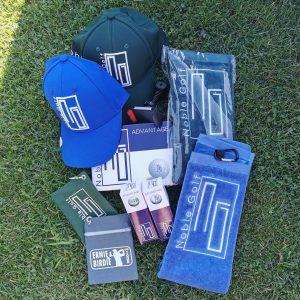 Das aktuelle Angebot von Noble Golf umfasst Bälle, Schlägertücher, Caps und Tee-Beutel