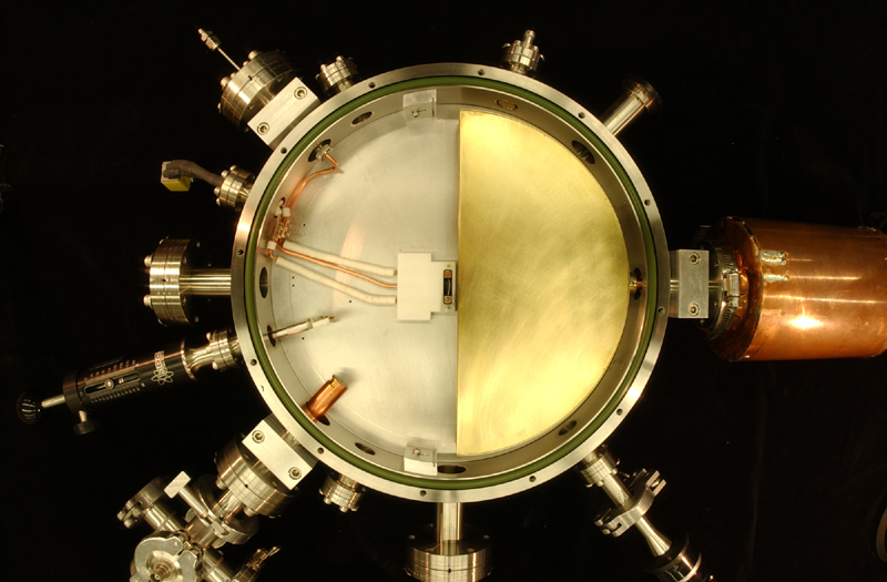 Fig.7 Top view of opened cyclotron chamber in August of 2004 (DUMMY dee removed for photo).