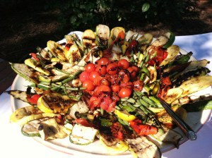 You can grill almost any vegetable in season - I'm partial to eggplant, zucchini, onions, bell pepper and bite sized grape tomatoes - serve with a drizzling of your favorite balsamic after they come off the grill and pair with some fresh mozzarella or burrata cheese and a loaf of grilled bread and you have the perfect party appetizer