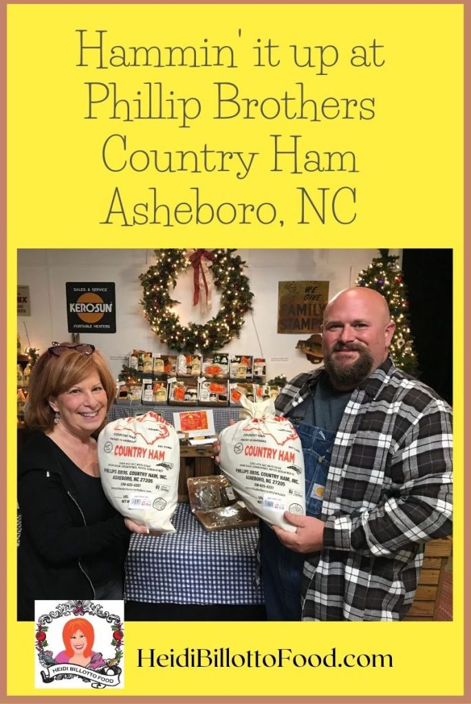 two people holding hams