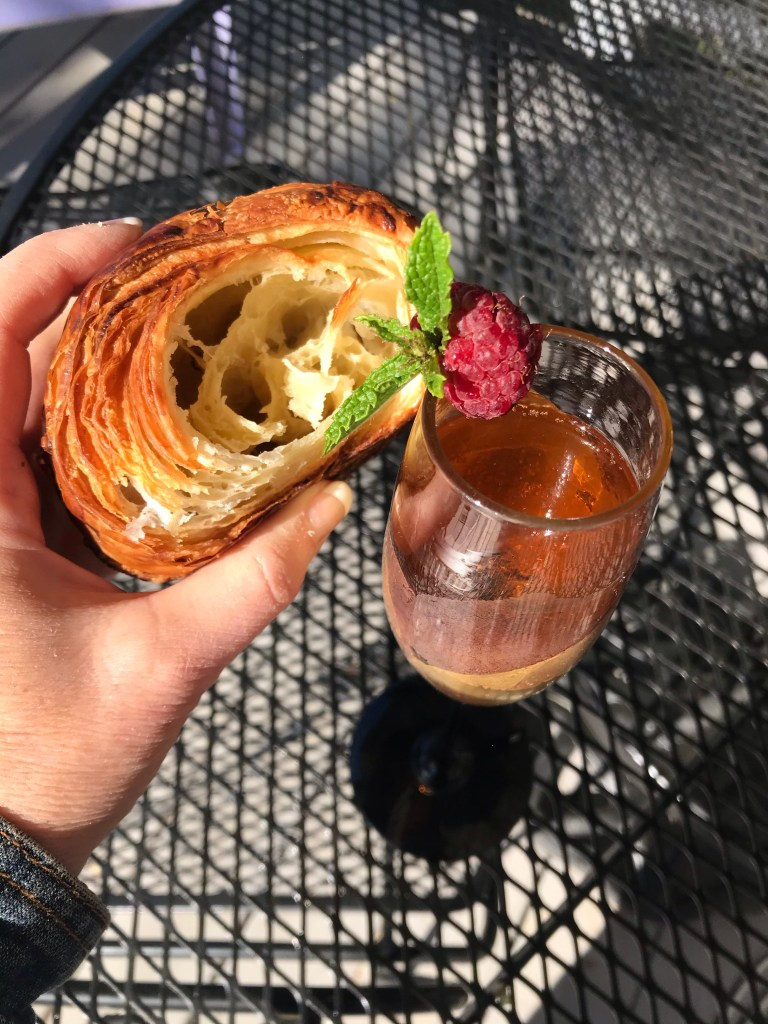 champagne and a croissnt