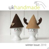 Hand drawn egg cup elves with felt hats and happy faces