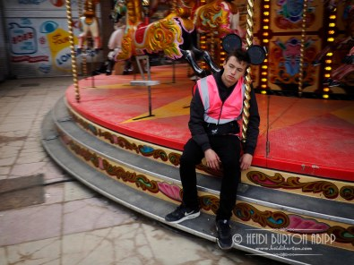 Enjoying his work on the Misery-go-round, Dismaland