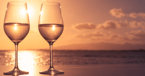 two-wine-glasses-sunset