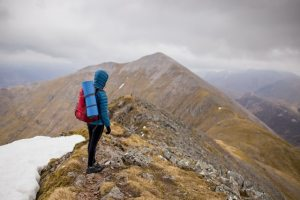 Man_Hiking_on_Peak