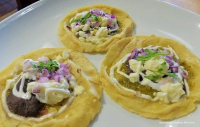 SOPES: Homemade corn tortilla boat, roasted poblano peppers, onion confit, crema casera, frijoles colados (vegetarian)