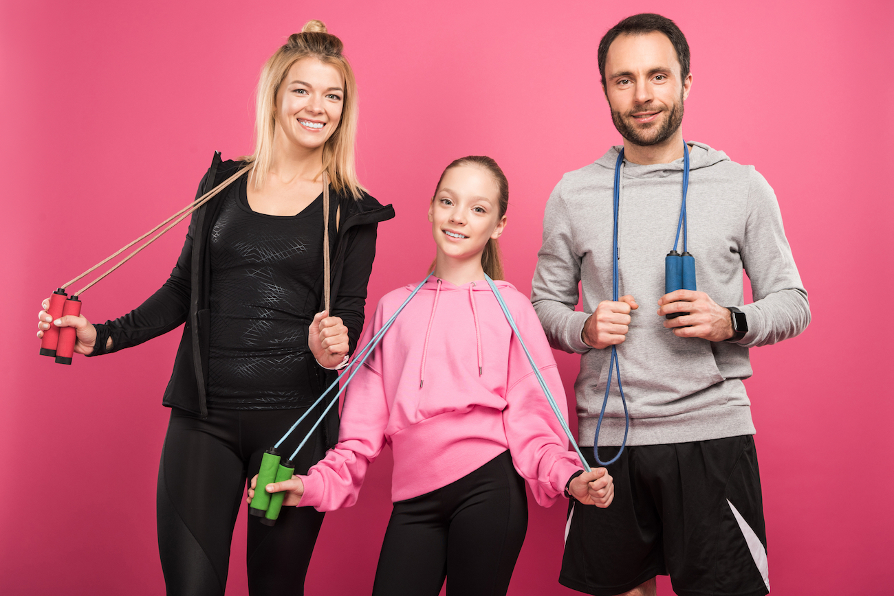 girl jump rope with parents