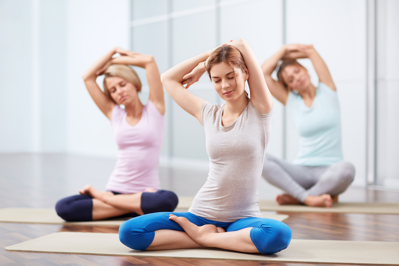 women stretching to keep good posture