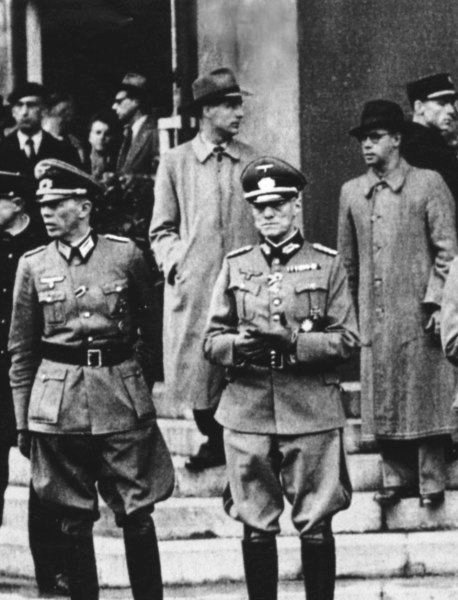 Marshal Henri Philippe Petain, left, meeting Adolf Hitler, October 24, 1940, in Montoire-sur-le-Loir, central France. German Foreign Minister Joachim von Ribbentrop is on right.  (2/2)