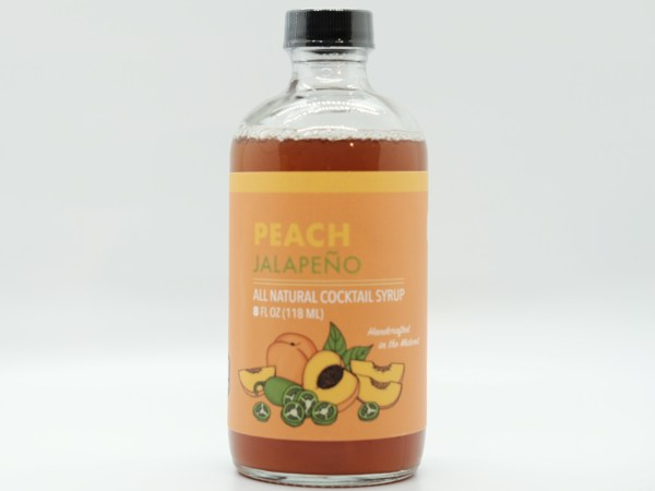 small peach shrub bottle