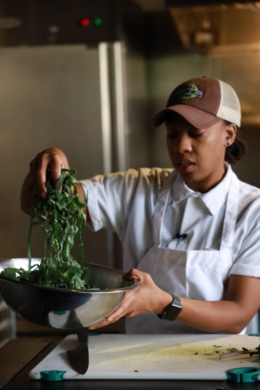 Chef Ashleigh Shanti prepares a collard salad