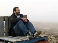 Aaron Kaplan sits on wooden pallets