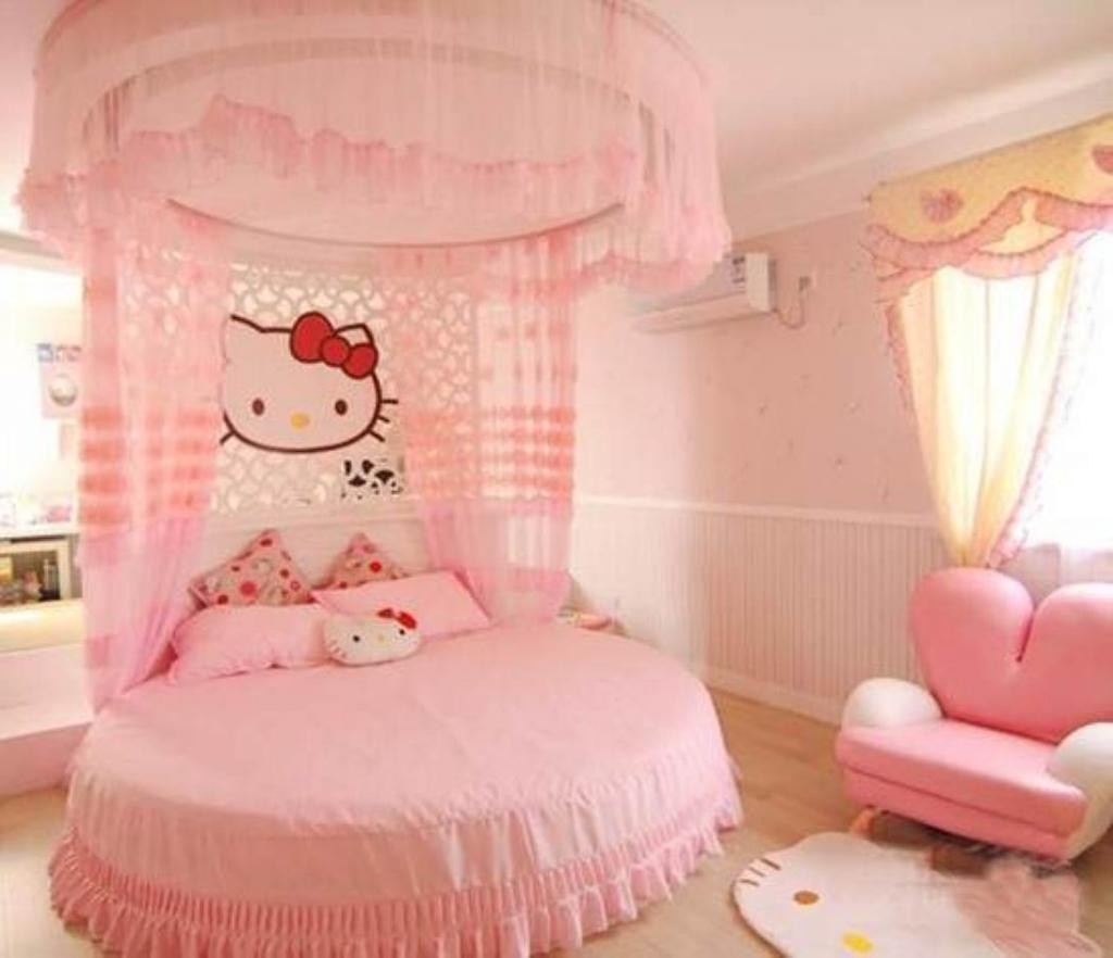 All Pink Colors Pink Round Bed And Canopy Bed For Cute Kids Bedroom Decor Idea With Hello Kitty Rug On Floor Beside Pink Chair Also Hello Kitty Partition Above Headboard X