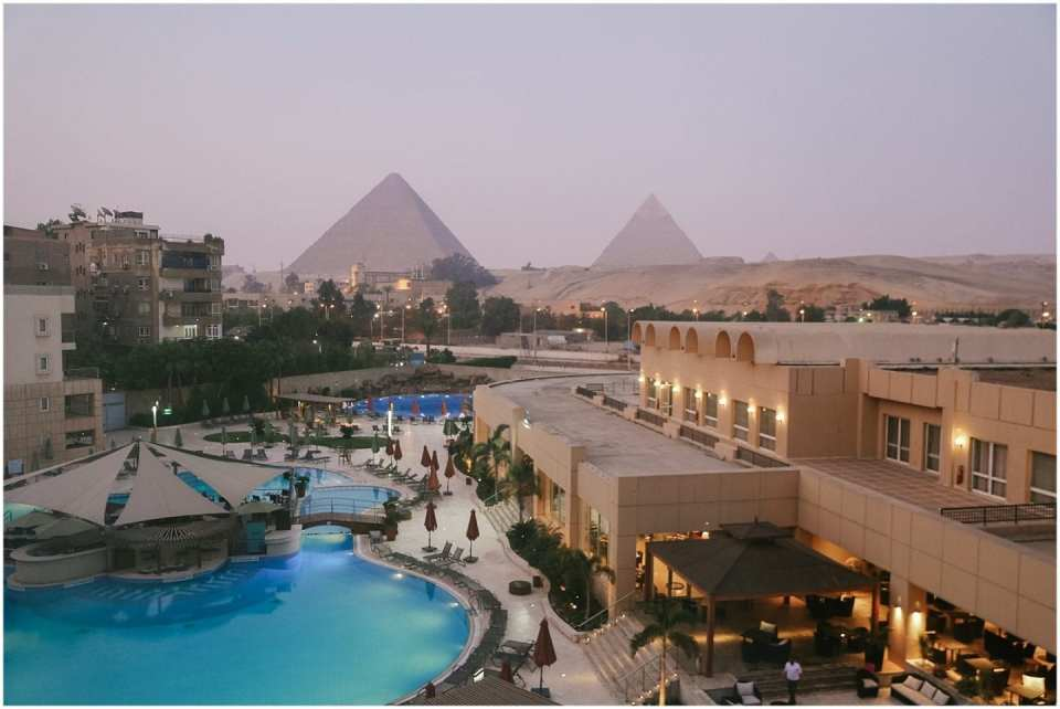 sunrise at Marriott Le Meridien Pyramids hotel pool view of Pyramids of Giza in Egypt