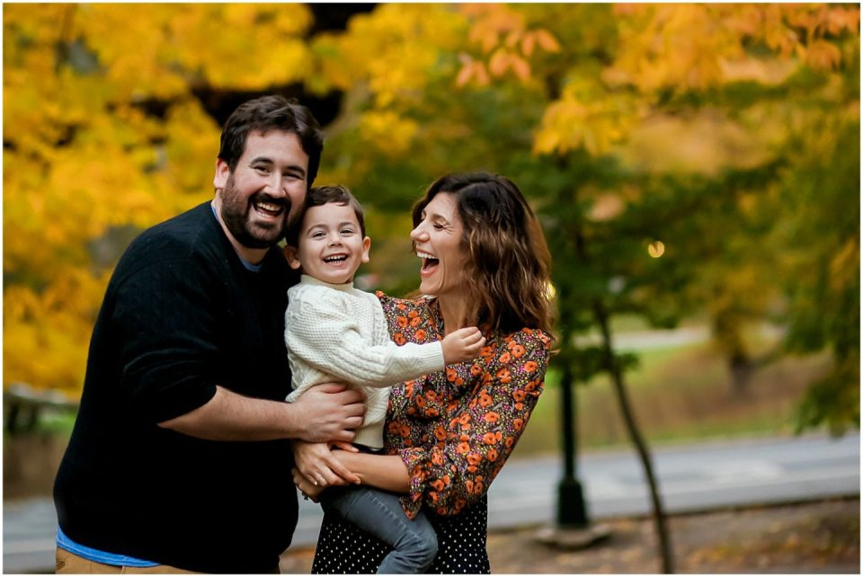 family in fall leaves with Fairfield CT family photographer Helena Woods